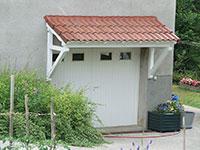 Portail de garage Anjou avec hublots